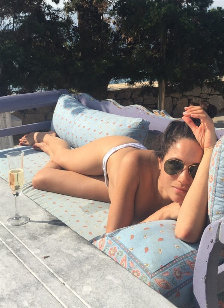 Meghan Markle topless outside on couch